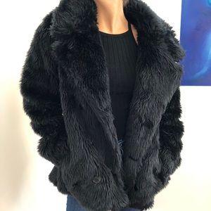 Black fur coat. Small rip on inside liner